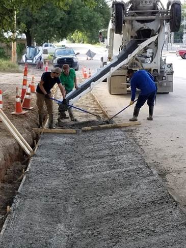 Construction workers performing road improvements in the City of Hamilton.