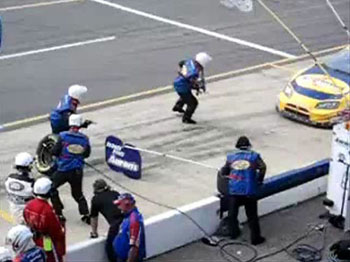 Photo of pit crew at a racetrack