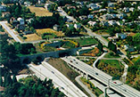 Aerial view of a highway near a city.