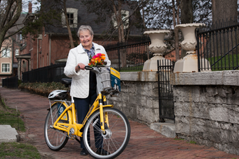 Photo shows an Indiana Pacers Bikeshare user with bike.