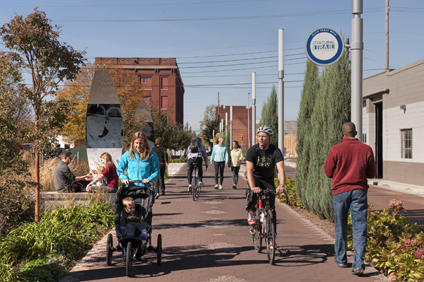 People walking and biking along the Indianapolis Cultural Trail.