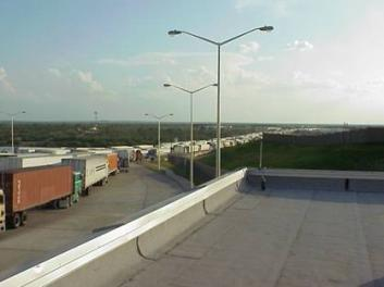 Hundreds of Tractor Trailers leaving the Laredo Port of Entry, many of which will use US 83