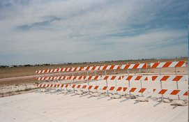 Photo of an orange and white barrier.