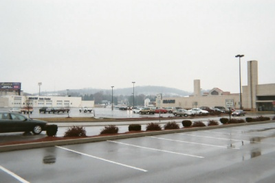 photo of a parking lot outside of a shopping center