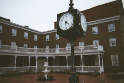 photo of an office building with a clock tower in front