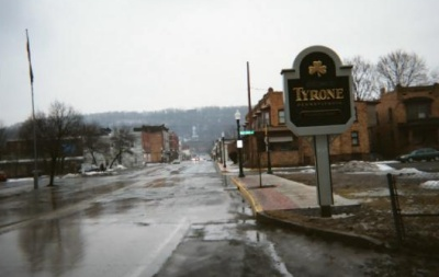 photo of a city street with welcome sign - Tyrone