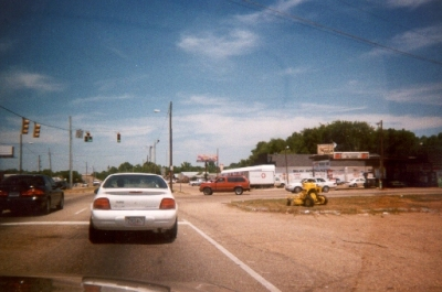 photo of cars at an intersection