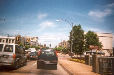 photo of cars at a stop light in an urban section of route 80