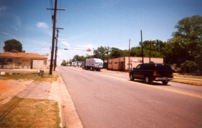 photo of a two lane road with trucks