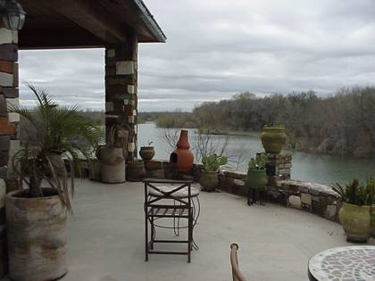 photo of a patio by a river