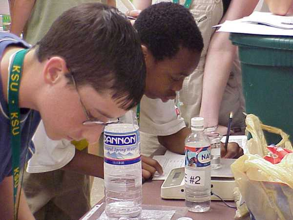 photo: Two students at a table. Click the image for a larger version.