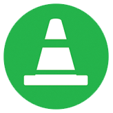 green and white icon depicting a roadway safety cone