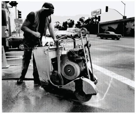 Photograph of sawcut being made in pavement